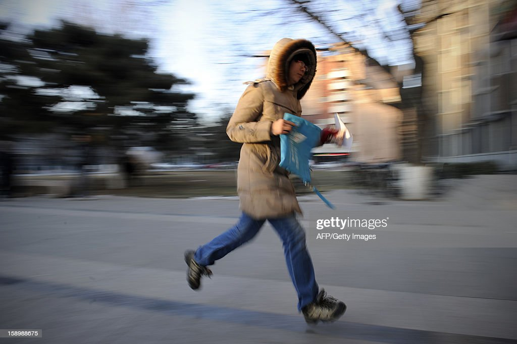 This picture taken on January 5, 2013 shows a candidate towards the exam room to sit the National Entrance Examination for Postgraduate (NEEP) at a university in Beijing. More than 1.8 million students will take the national postgraduate entrance exam from January 5 to 6.