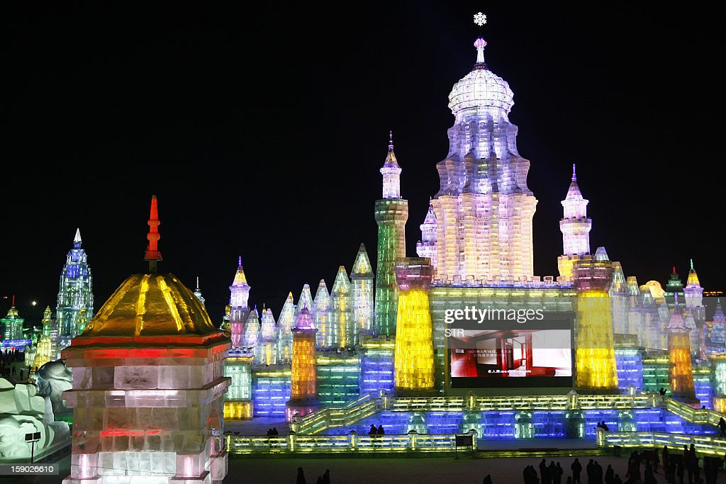 This picture taken on January 5, 2013 shows a huge ice castle in Ice and Snow World at the opening ceremony of the 2013 Harbin International Ice and Snow Festival in Harbin, in northeast China's Heilongjiang province. This year's 'Ice and Snow World' features majestic ice castles and sculptures of fairytale characters equipped with LED lights, bringing a colourful and warm aura to the icy wonderland. CHINA OUT AFP PHOTO