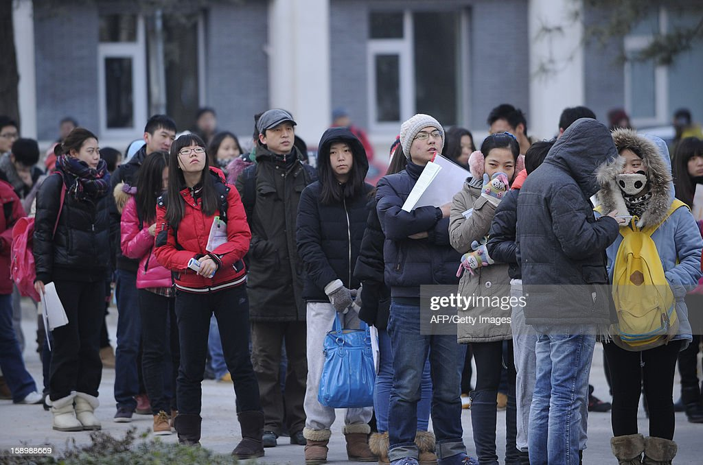 This picture taken on January 5, 2013 shows candidates waiting to enter into the exam room to sit the National Entrance Examination for Postgraduate (NEEP) at a university in Beijing. More than 1.8 million students will take the national postgraduate entrance exam from January 5 to 6. AFP PHOTO / WANG ZHAO