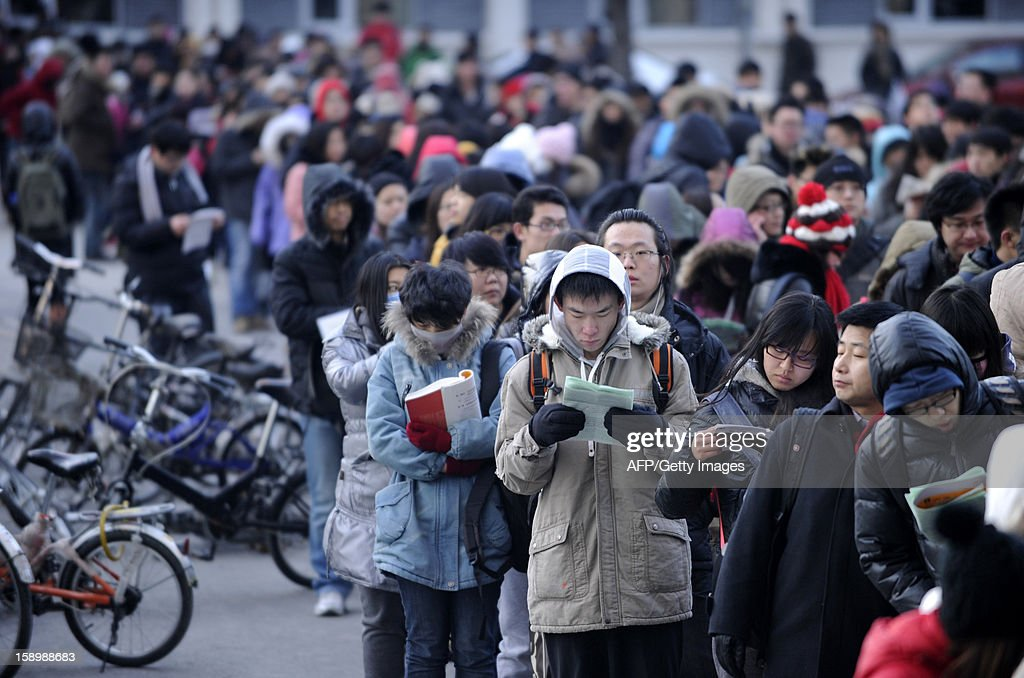 This picture taken on January 5, 2013 shows candidates waiting to enter into the exam room to sit the National Entrance Examination for Postgraduate (NEEP) at a university in Beijing. More than 1.8 million students will take the national postgraduate entrance exam from January 5 to 6.