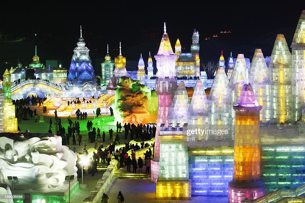 This picture taken on January 5, 2013 shows colorful ice castles in Ice and Snow World at the opening ceremony of the 2013 Harbin International Ice and Snow Festival in Harbin, in northeast China's Heilongjiang province. This year's 'Ice and Snow World' features majestic ice castles and sculptures of fairytale characters equipped with LED lights, bringing a colourful and warm aura to the icy wonderland. CHINA