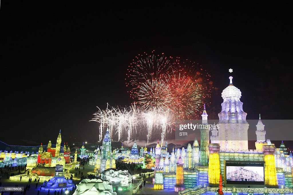 This picture taken on January 5, 2013 shows fireworks bursting in the sky over Ice and Snow World at the opening ceremony of the 2013 Harbin International Ice and Snow Festival in Harbin, in northeast China's Heilongjiang province. This year's 'Ice and Snow World' features majestic ice castles and sculptures of fairytale characters equipped with LED lights, bringing a colourful and warm aura to the icy wonderland. CHINA OUT AFP PHOTO