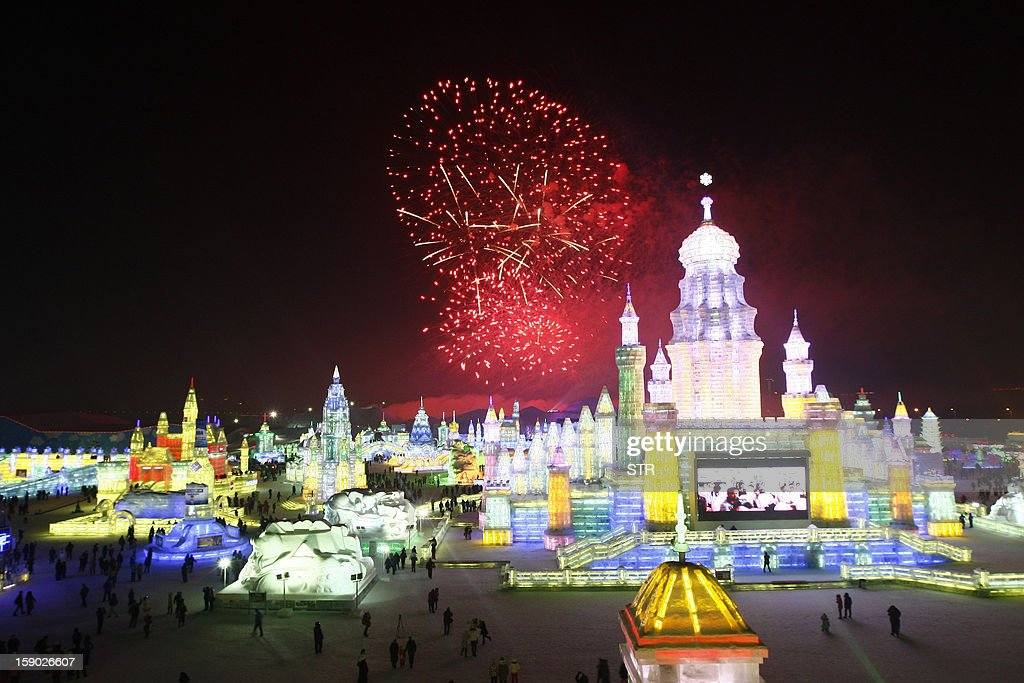 This picture taken on January 5, 2013 shows fireworks bursting in the sky over Ice and Snow World at the opening ceremony of the 2013 Harbin International Ice and Snow Festival in Harbin, in northeast China's Heilongjiang province. This year's 'Ice and Snow World' features majestic ice castles and sculptures of fairytale characters equipped with LED lights, bringing a colourful and warm aura to the icy wonderland. CHINA