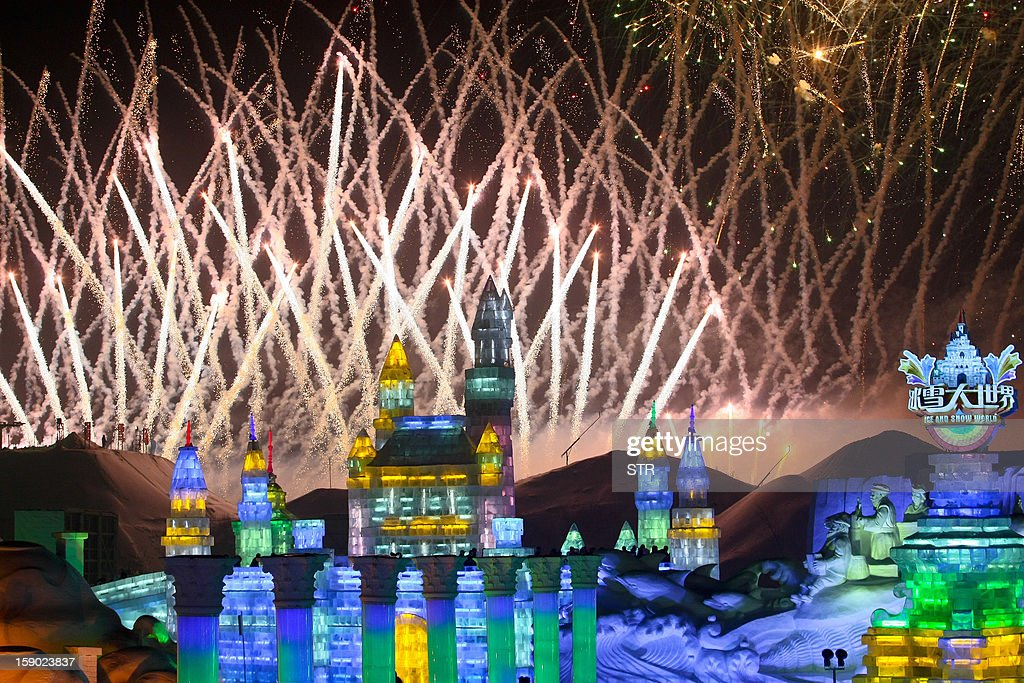 This picture taken on January 5, 2013 shows fireworks bursting into the sky over Ice and Snow World at the opening ceremony of the 2013 Harbin Internatoinal Ice and Snow Festival in Harbin, in northeast China's Heilongjiang province. This year's 'Ice and Snow World' features majestic ice castles and sculptures of fairytale characters equipped with LED lights, bringing a colourful and warm aura to the icy wonderland. CHINA