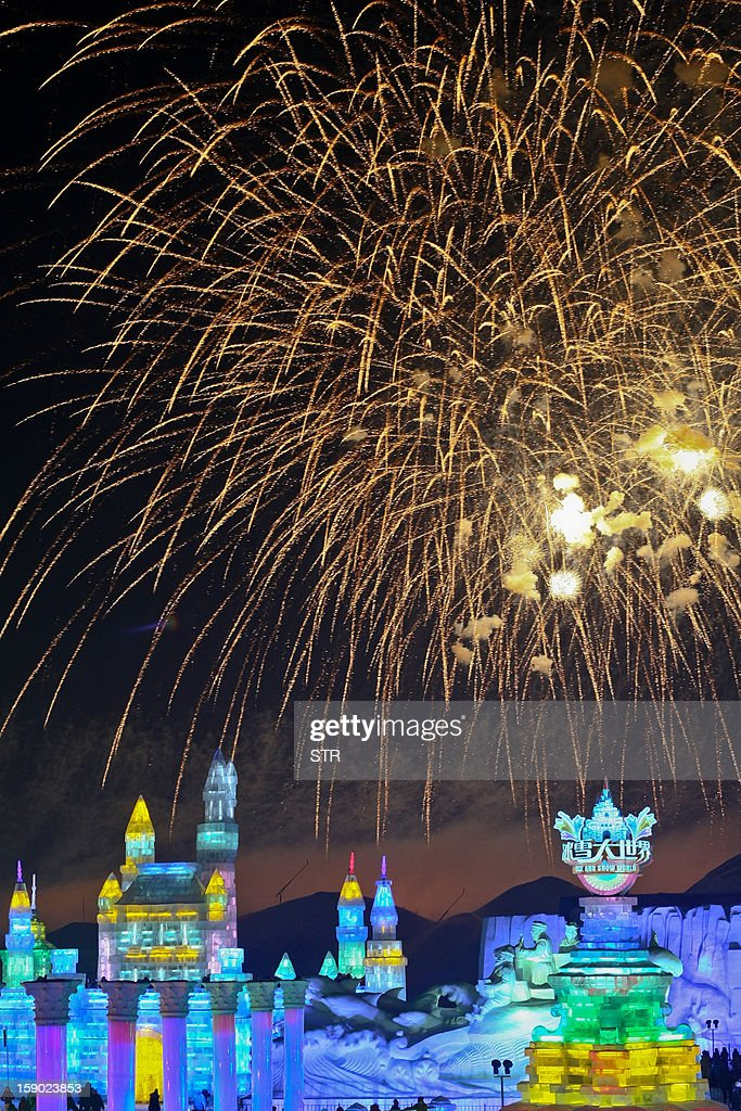 This picture taken on January 5, 2013 shows fireworks in the sky over Ice and Snow World at the opening ceremony of the 2013 Harbin Internatoinal Ice and Snow Festival in Harbin, in northeast China's Heilongjiang province. This year's 'Ice and Snow World' features majestic ice castles and sculptures of fairytale characters equipped with LED lights, bringing a colourful and warm aura to the icy wonderland. CHINA OUT AFP PHOTO
