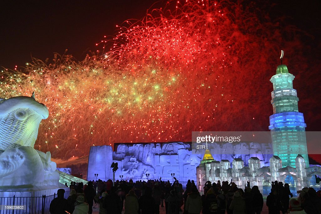 This picture taken on January 5, 2013 shows people visiting Ice and Snow World at the opening ceremony of the 2013 Harbin Internatoinal Ice and Snow Festival in Harbin, in northeast China's Heilongjiang province. This year's 'Ice and Snow World' features majestic ice castles and sculptures of fairytale characters equipped with LED lights, bringing a colourful and warm aura to the icy wonderland. CHINA OUT AFP PHOTO
