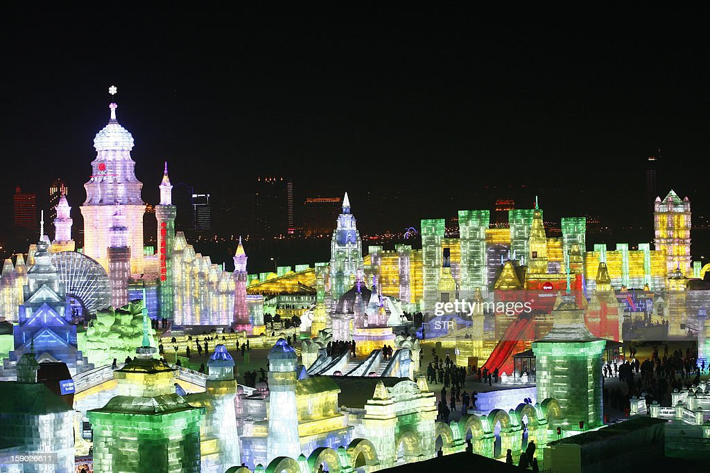 This picture taken on January 5, 2013 shows the Ice and Snow World decorated with colourful lights at the opening ceremony of the 2013 Harbin International Ice and Snow Festival in Harbin, in northeast China's Heilongjiang province. This year's 'Ice and Snow World' features majestic ice castles and sculptures of fairytale characters equipped with LED lights, bringing a colourful and warm aura to the icy wonderland. CHINA OUT AFP PHOTO