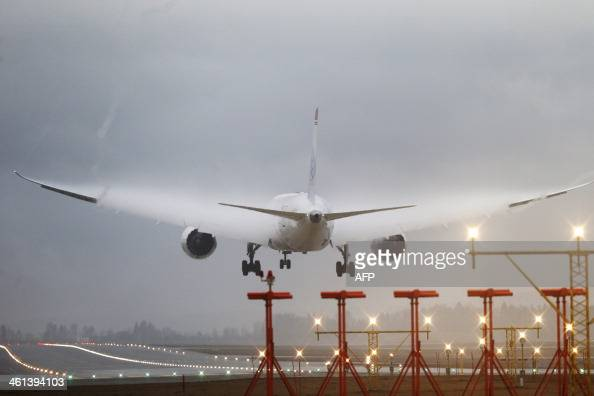 This picture taken on January 8 2014 shows Norwegian airline's Boeing DY7002 arriving from New York at Oslo airport Norwegian airline has experienced...