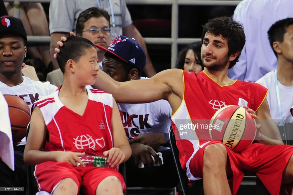 This picture taken on July 1, 2013 shows Spanish NBA player for Minnesota Timberwolves,Ricky Rubio (R) attending the 2013 Yao Foundation Charity Game in Beijing. The game between China team and the NBA Stars team was sponsored by the charity foundation initiated by former Chinese basketball star Yao Ming. CHINA OUT AFP PHOTO