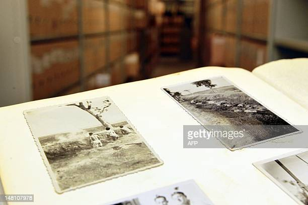 This picture taken on July 10 2012 shows a photo album found in a garbage can in Enschede with pictures showing an execution in former Dutch East...
