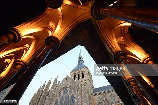 This picture taken on July 11 2013 shows Mont SaintMichel abbey a Unesco world heritage site in northern France A dam is being constructed over the...