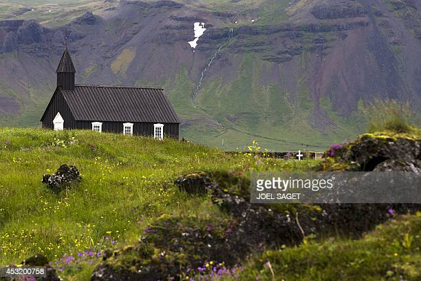 This picture taken on July 11 2014 shows the old church of Budir a small hamlet in lava fields in the Snaefellsnes peninsula western Iceland AFP...
