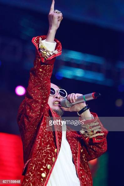 This picture taken on July 11 2016 shows Mongolian rapper Amarmandakh Sukhbaatar performing in Ulan Bator Amarmandakh Sukhbaatar one of Mongolia's...