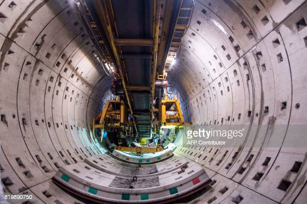 This picture taken on July 11 2017 shows part of the construction site of Line 14 for the Shanghai metro system Deep underneath Shanghai workers on a...