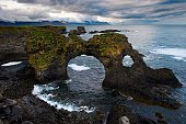 This picture taken on July 12 2014 shows the Gatklettur a stone arch on the coast in the Snaefellsnes peninsula western Iceland AFP PHOTO / JOEL SAGET
