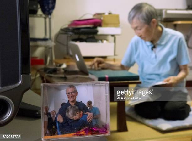 This picture taken on July 13 2017 shows a commemorative photo with Apple CEO Tim Cook and 82yearold programmer Masako Wakamiya displayed in her home...