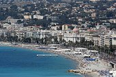 TOPSHOT This picture taken on July 17 shows a general view of the beach and the Promenade des Anglais in the French riviera city of Nice three days...