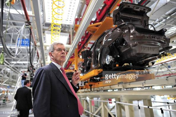 This picture taken on July 2 2013 shows Philippe Varin CEO of PSA Peugeot Citroen visiting the production line in a new plant of Dongfeng...
