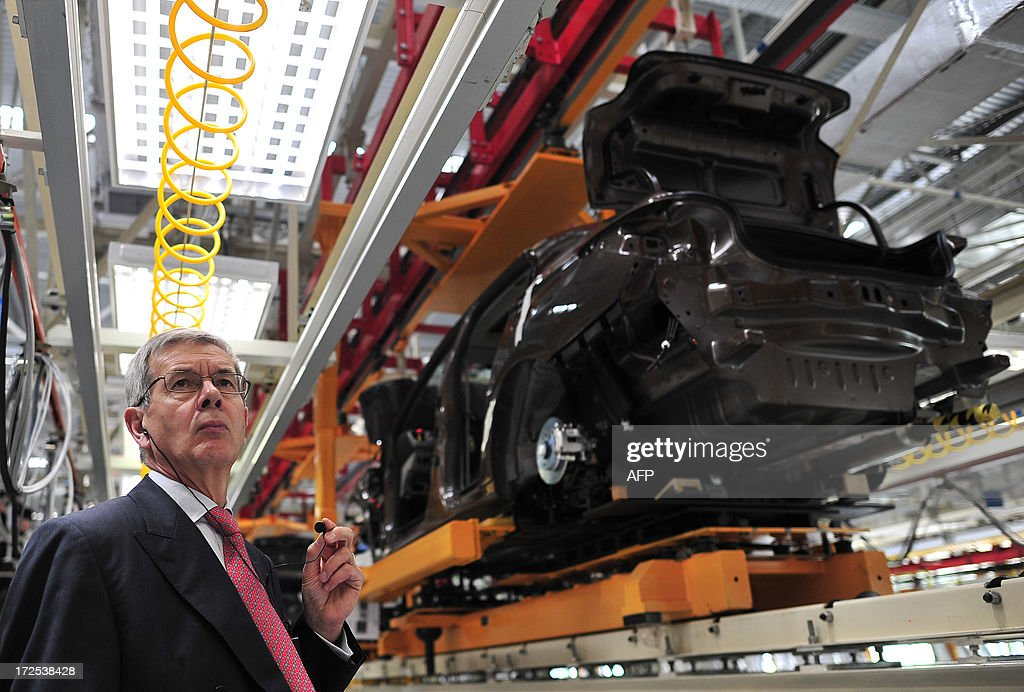 This picture taken on July 2, 2013 shows Philippe Varin, CEO of PSA Peugeot Citroen, visiting the production line in a new plant of Dongfeng Peugeot-Citroën Automobile Limited (DPCA) in Wuhan, central China's Hubei province. China's second biggest automaker, Dongfeng, has held talks about buying a stake in troubled French car firm PSA Peugeot Citroen, a state-backed newspaper said on July 3. CHINA