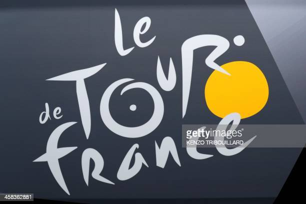 This picture taken on July 2 2016 shows the Tour de France logo prior to the 188 km first stage of the 103rd edition of the Tour de France cycling...