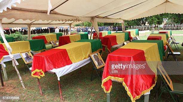 This picture taken on July 21 shows coffins on July 21 2016 in Segou during a funeral ceremony Mali announced on July 21 it had opened an...