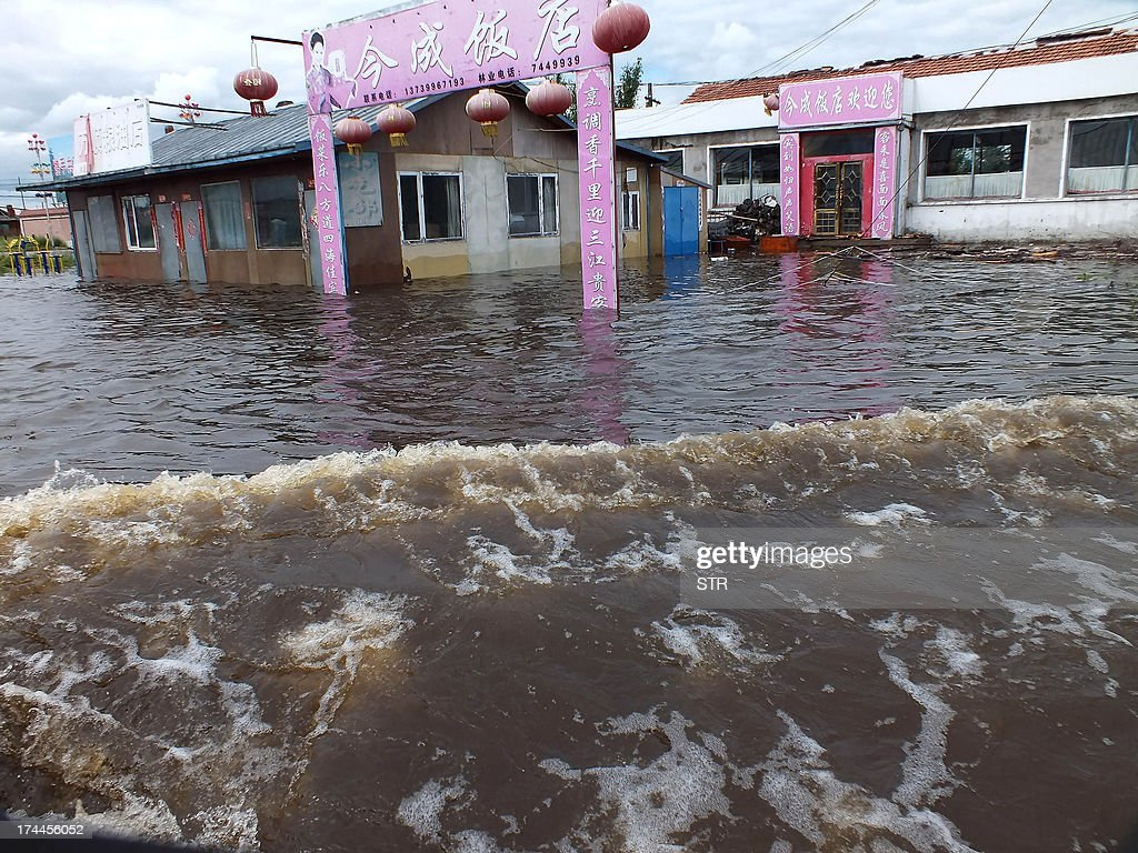This picture taken on July 25, 2013 shows a flooded restaurant in Yakeshi, in northern China's Inner Mongolia region. Floods this year have struck across 30 provinces and municipalities and affected more than 47 million people, according to the Office of State Flood Control and Drought Relief Headquarters on July 21. CHINA