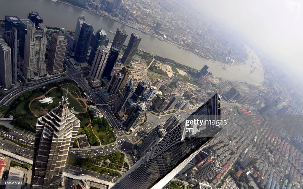 This picture taken on July 25 2013 shows the Shanghai Global Financial Hub and Jin Mao Tower from the Shanghai Tower in the Lujiazui area of Pudong...