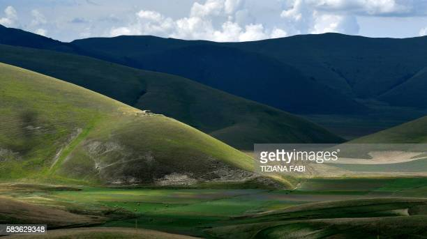 This picture taken on July 25 2016 shows a panoramic view of the lentil fields near Castelluccio a small village in central Italys Umbria region /...