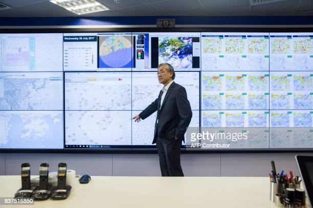 This picture taken on July 26 2017 shows the director of the Hong Kong Observatory Shun Chiming explaining the equipment used to monitor weather at...