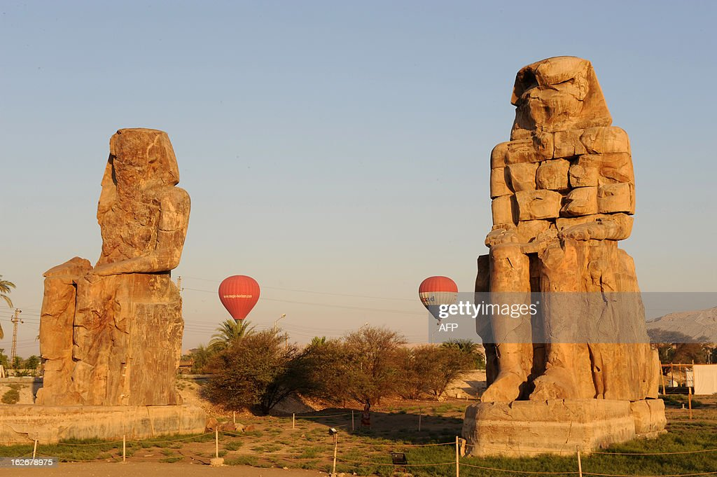 This picture taken on July 29, 2008 shows hot air balloons flying over ancient ancient temple city of Luxor. A hot air balloon caught fire and exploded over Egypt's ancient temple city of Luxor during a sunrise flight on February 26, 2013, killing up to 19 tourists, including Asians and Europeans. AFP PHOTO / GIUSEPPE CACACE