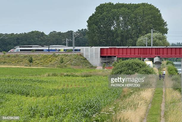This picture taken on July 3 2016 shows a French TGV highspeed train crossing the bridge in Eckwersheim eastern France on the first day of the new...