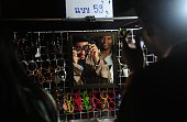 This picture taken on July 3 2016 shows men shopping for sunglasses at a market in Thailand's southern province of Narathiwat ahead of the Eid alFitr...