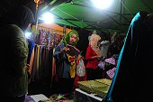 This picture taken on July 3 2016 shows women shopping for clothing at a market in Thailand's southern province of Narathiwat ahead of the Eid alFitr...