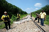 This picture taken on July 4 2016 shows government officers inspecting a railroad damaged by a bomb planted by suspected separatist militants in the...