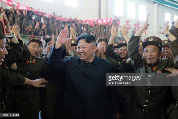 This picture taken on July 4 2017 and released from North Korea's official Korean Central News Agency on July 5 2017 shows North Korean leader Kim...