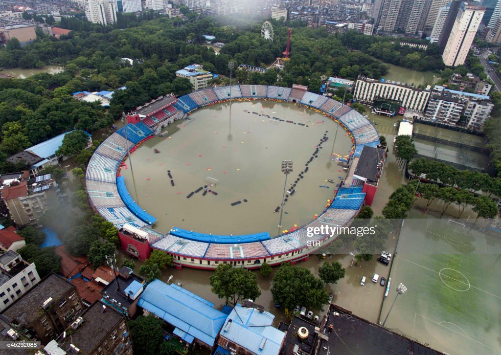 TOPSHOT This picture taken on July 6 2016 shows the flooded Xinhua Road Sports Centre Stadium in Wuhan central China's Hubei province Heavy rain...