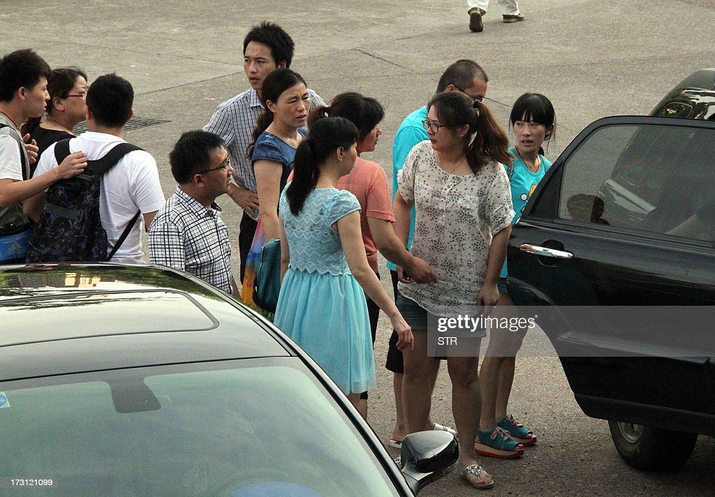 This picture taken on July 7, 2013 shows parents of students that were onboard a crashed South Korean passenger jet at San Francisco airport, leaving the schoolyard in Jiangshan, east China's Zhejiang province. China mourned two teenage girls killed after a South Korean passenger jet crashed at San Francisco airport as survivors recounted harrowing details of their flight, as Chinese nationals made up 141 of the 291 passengers aboard the Asiana Airlines Boeing 777 which burst into flames after it landed short of the runway, injuring 182. CHINA