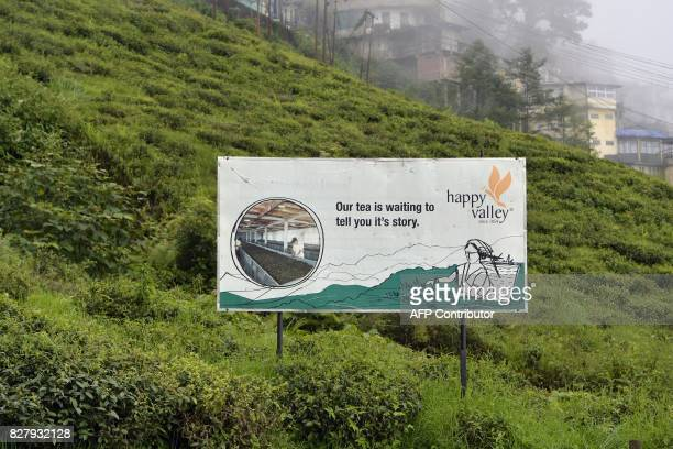 This picture taken on July 7 2017 shows billboard advertising at the Happy Valley Tea Garden which is empty of workers during an indefinite strike in...