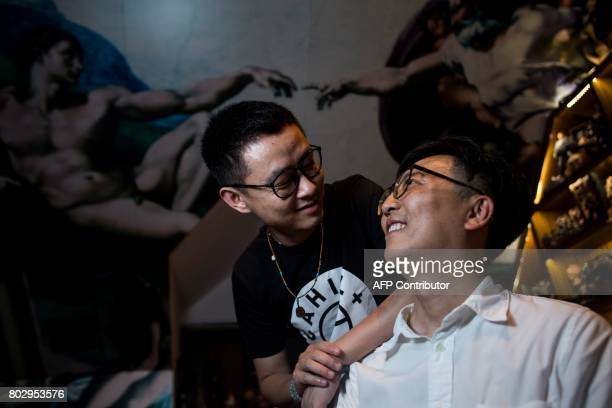 This picture taken on June 1 2017 shows Duan Rongfeng and Li Tao posing for a picture in their apartment in Shanghai Comingout in familyoriented...