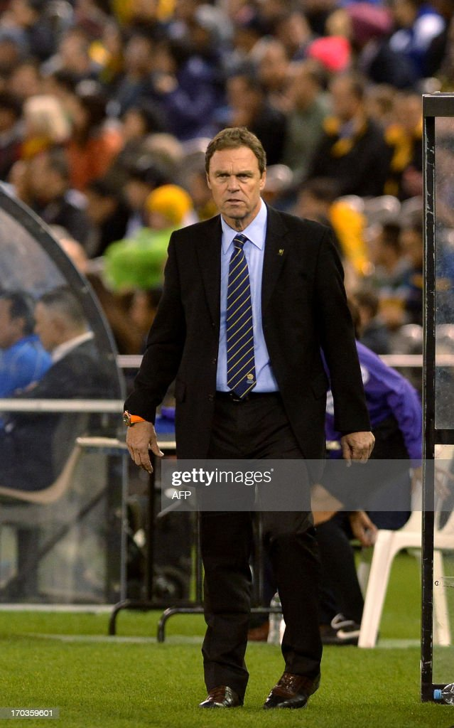 This picture taken on June 11, 2013 shows Australia's Coach Holger Osieck watches his team during their 2014 World Cup football qualifier against Jordan in Melbourne. Holger apologised after being caught on camera making a sexist slur, saying 'women should shut up in public'. The German made the comment as he prepared to face the media after Australia beat Jordan 4-0 in Melbourne on June 11, 2013 to move within one win of making the 2014 World Cup finals in Brazil.--IMAGE RESTRICTED TO EDITORIAL USE - STRICTLY NO COMMERCIAL USE -- AFP PHOTO / Paul CROCK
