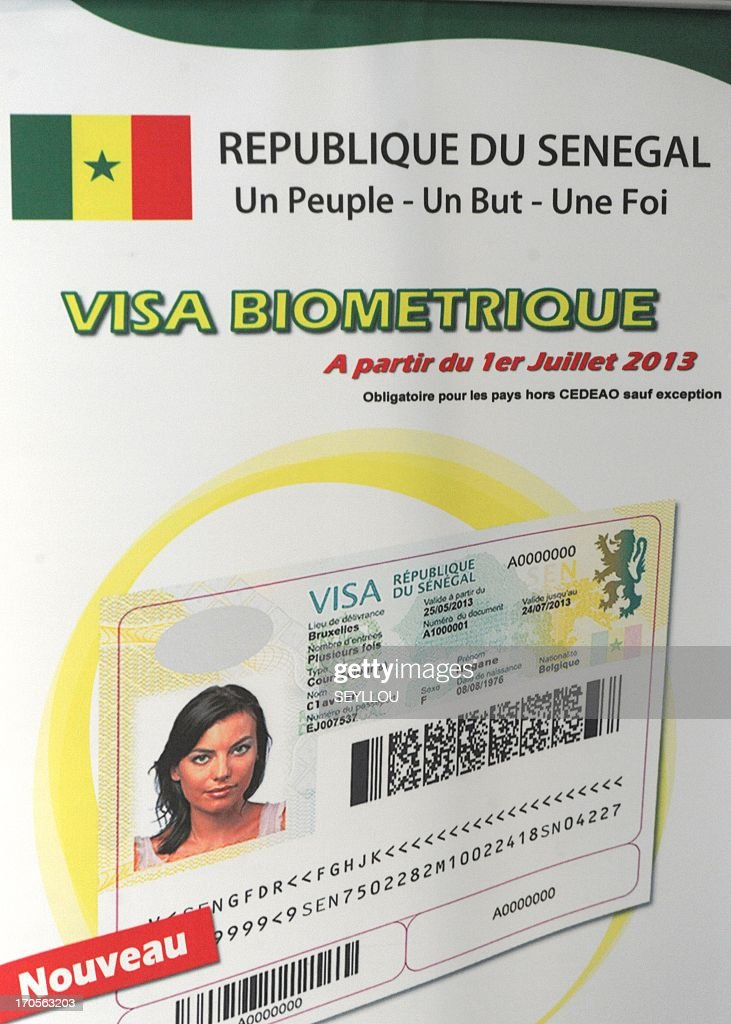 This picture taken on June 14, 2013 shows a poster depicting the new Senegalese biometric visa that will be launched on July 1, 2013.