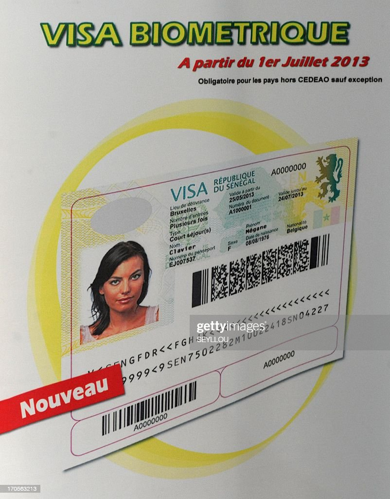 This picture taken on June 14, 2013 shows a poster depicting the new Senegalese biometric visa that will be launched on July 1, 2013. AFP PHOTO / SEYLLOU