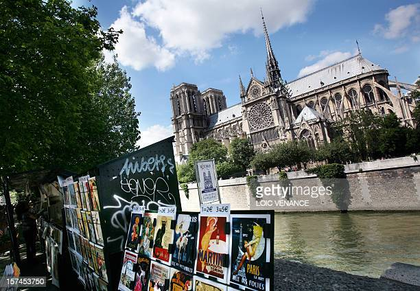 This picture taken on June 16 2009 in Paris shows NotreDame de Paris cathedral and used book sellers set up on the Seine River banks AFP PHOTO LOIC...
