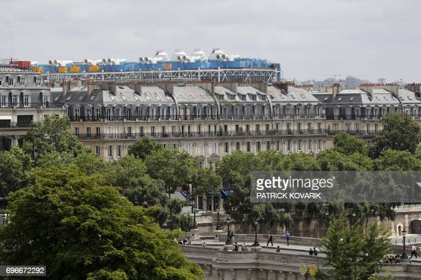 This picture taken on June 16 2017 in Paris shows Beaubourg's roof and the Pont Neuf / AFP PHOTO / PATRICK KOVARIK