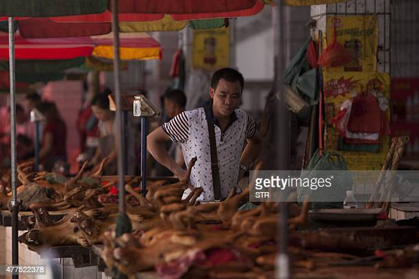 This picture taken on June 17 2015 shows dog meat on sale at a market in Yulin in southern China's Guangxi province People from Yulin traditionally...