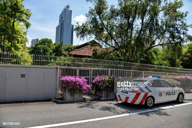 This picture taken on June 17 2017 shows a police car driving past the house of Singapore's late prime minister Lee Kuan Yew at 38 Oxley Road in...