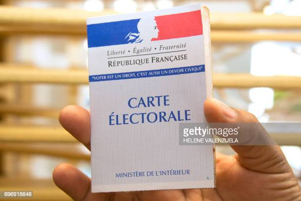 This picture taken on June 17 shows an electoral card during the second round of the French legislative elections at a polling station in...