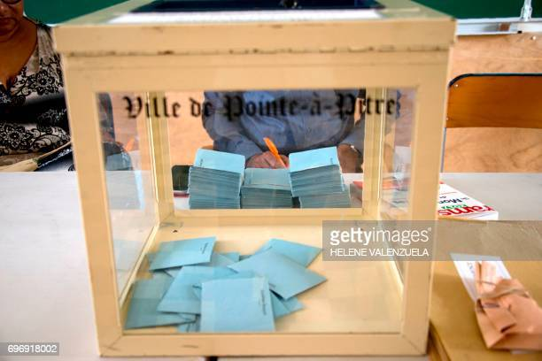 This picture taken on June 17 shows ballots in the box during the second round of the French legislative elections at a polling station in...
