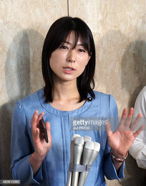 This picture taken on June 19 2014 shows Ayaka Shiomura a member of the Tokyo metropolitan assembly speaking to reporters at the Tokyo city hall The...