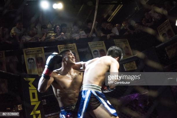 TOPSHOT This picture taken on June 2 2017 shows Chinese men fighting in an underground club in Chengdu Every Friday night fighters trade blows in a...